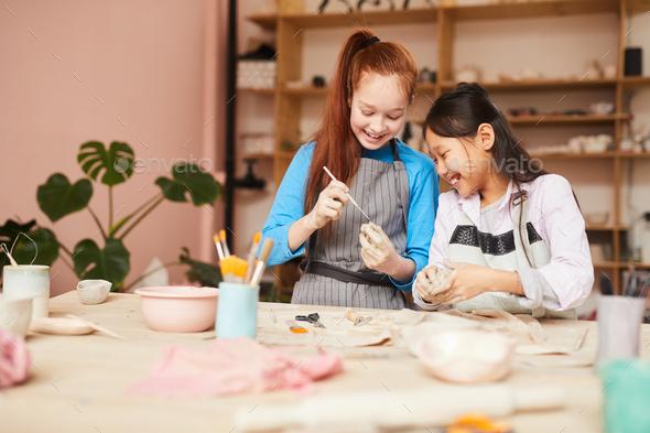 Girls Enjoying Pottery Workshop - Stock Photo - Images