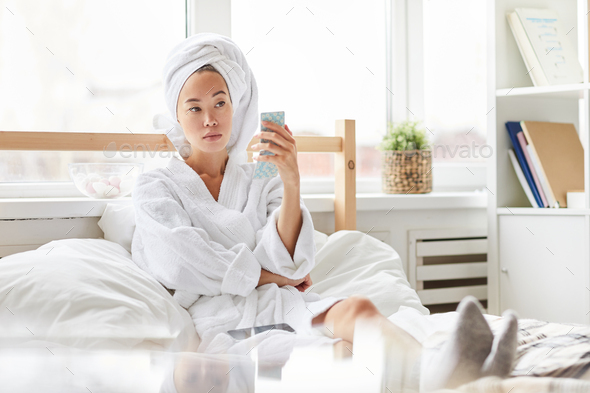 Asian Woman Relaxing in Morning - Stock Photo - Images