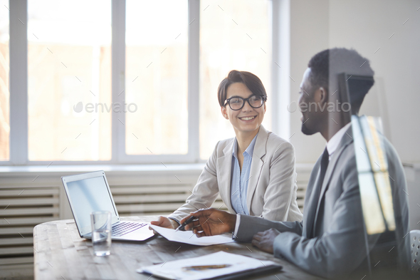 Colleagues discussing papers - Stock Photo - Images