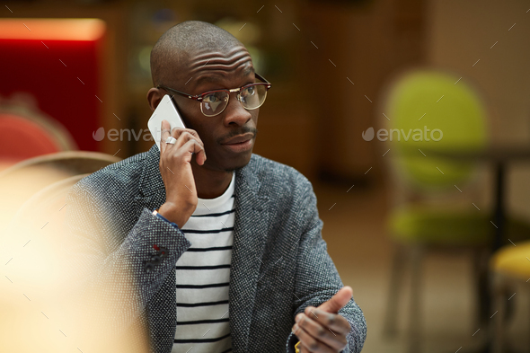 Contemporary African ManTalking by Phone - Stock Photo - Images