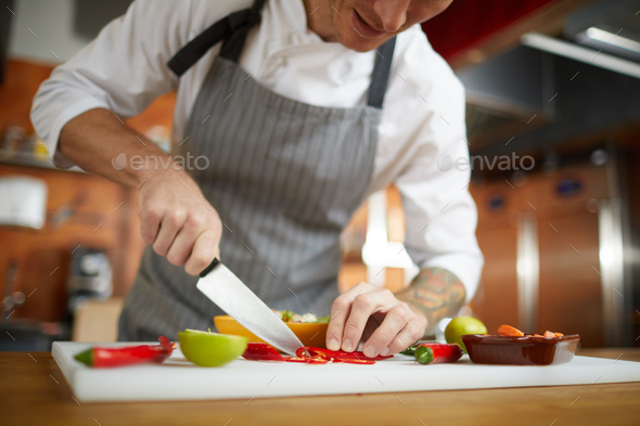 Chef Cutting Vegetables Closeup - Stock Photo - Images