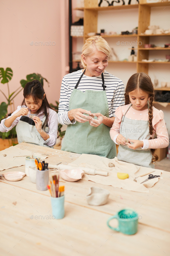 Little Girls in Pottery Workshop - Stock Photo - Images