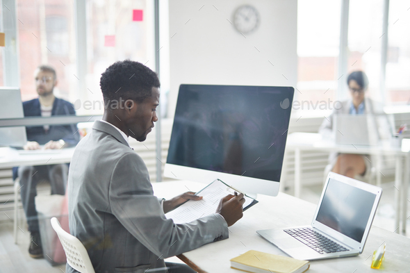 Reading document in office - Stock Photo - Images
