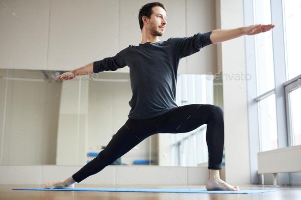 Slim man doing standing yoga pose - Stock Photo - Images