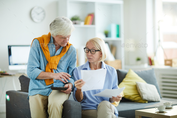 Mature Couple Calculating Budget - Stock Photo - Images
