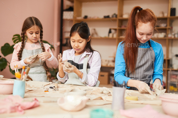 Three Girls in Pottery Workshop - Stock Photo - Images