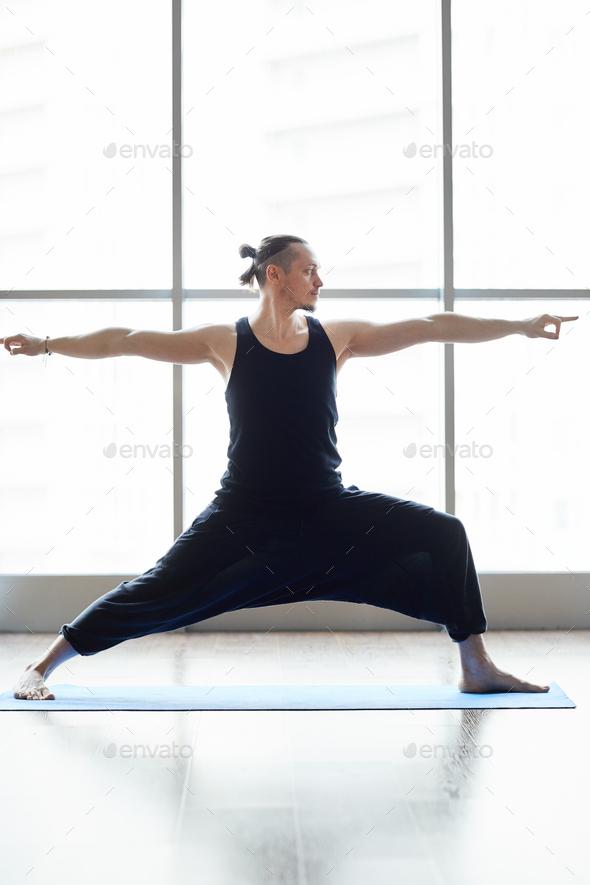 Yogis doing balance exercise - Stock Photo - Images