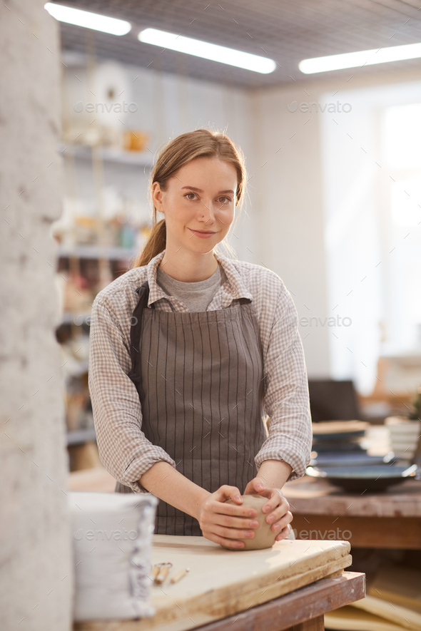 Kneading clay with hands - Stock Photo - Images