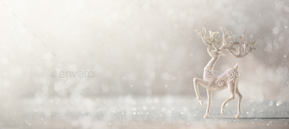 Silver glitter Christmas deer on grey background with lights bokeh, copy space. Greeting card for - Stock Photo - Images