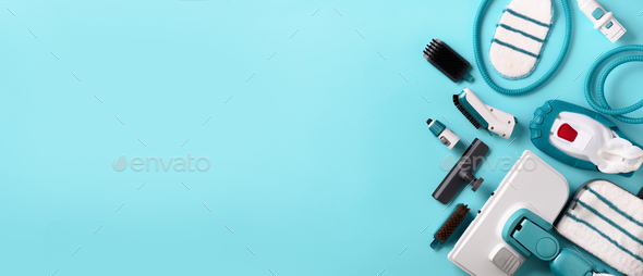 Set with modern professional steam cleaners on blue background. Top view, flat lay. Banner with copy - Stock Photo - Images
