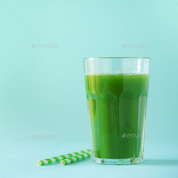 Glass of green celery smoothie on blue background. Banner with copy space. Fresh juice for detox - Stock Photo - Images