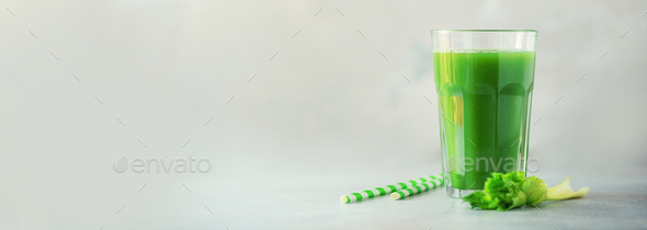 Glass of green celery smoothie on grey concrete background. Banner with copy space. Fresh juice for - Stock Photo - Images