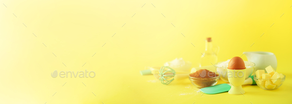 Turquoise and yellow cooking utensils on bright background. Food ingredients. Macro of eggs. Cooking - Stock Photo - Images