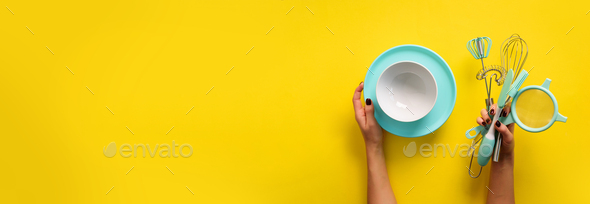 Baking flat lay. Female hands holding plate, bowl, kitchen tools, sieve, rolling pin, spatula and - Stock Photo - Images