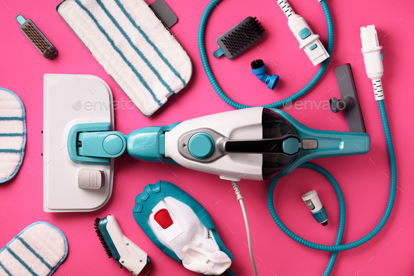 Kit of modern professional steam cleaners on pink background. Top view, flat lay. Banner with copy - Stock Photo - Images
