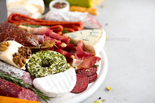 Cheese and meat appetizer. Traditional italian antipasto. Cutting board with salami, cold smoked - Stock Photo - Images