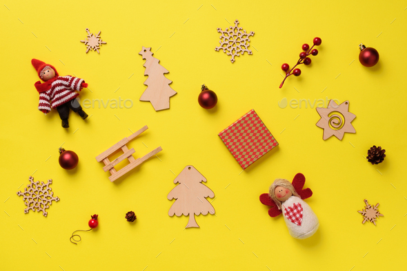 Greeting card for New year party. Christmas gifts, decorative elements and ornaments on yellow - Stock Photo - Images