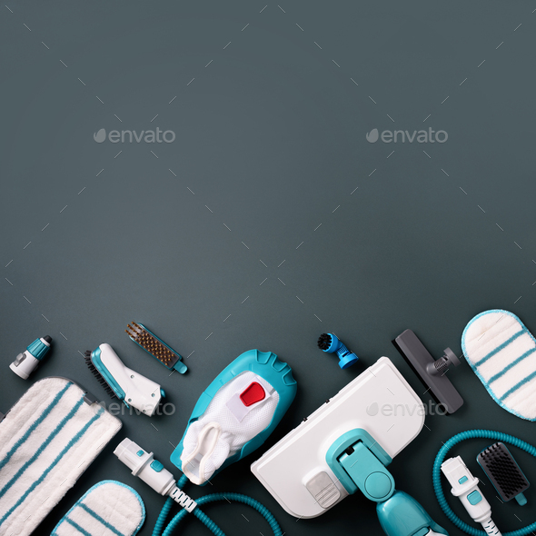 Set with modern professional steam cleaners on grey background. Top view, flat lay. Banner with copy - Stock Photo - Images