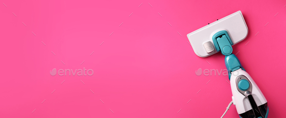 Steam cleaner mop on pink background. Top view, flat lay. Banner with copy space. Cleaning service - Stock Photo - Images