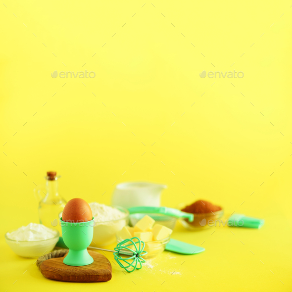 Bakery food frame, cooking concept. Different baking ingredients - butter, sugar, flour, milk, eggs - Stock Photo - Images