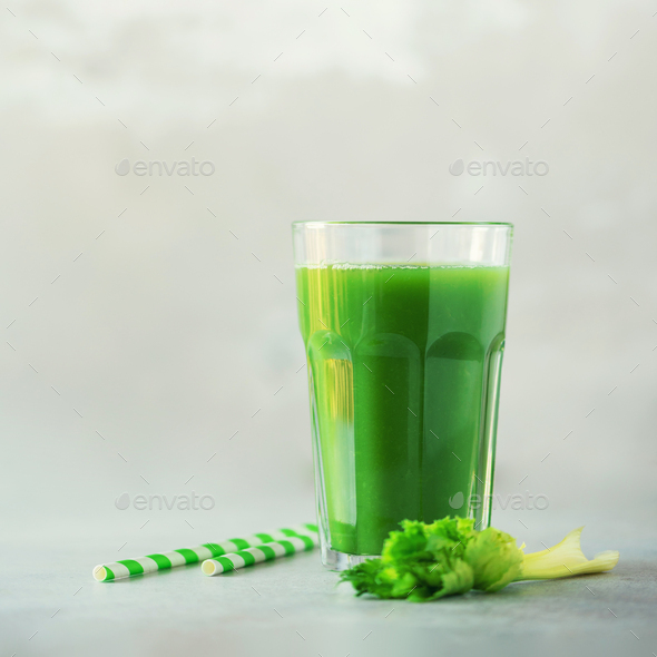 Glass of green celery smoothie on grey concrete background. Banner with copy space. Square crop - Stock Photo - Images