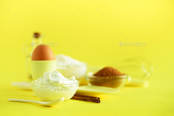 Holiday bakery background. Food frame - butter, sugar, flour, milk, eggs, oil, spoon, rolling pin - Stock Photo - Images