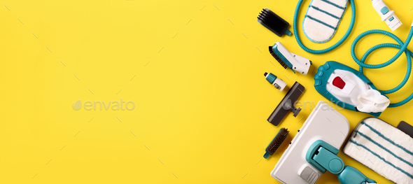 Set with modern professional steam cleaners on yellow background. Top view, flat lay. Banner with - Stock Photo - Images
