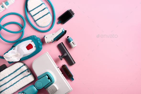 Set with modern professional steam cleaners on pink background. Top view, flat lay. Banner with copy - Stock Photo - Images