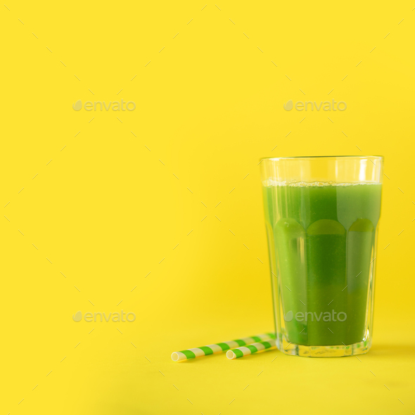 Glass of green celery smoothie on yellow background. Banner with copy space. Square crop. Vegan - Stock Photo - Images