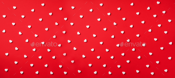Seamless pattern. White hearts on red background. Top view. Valentine's Day. Love, date - Stock Photo - Images