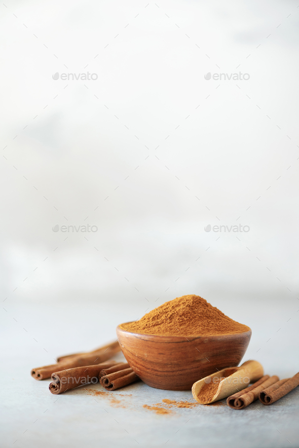 Cinnamon sticks and powder on grey background. Spices for ayurvedic treatment. Alternative medicine - Stock Photo - Images