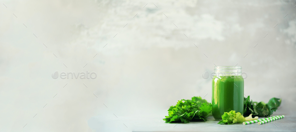 Bottle of green celery smoothie on grey concrete background. Banner with copy space. Square crop - Stock Photo - Images