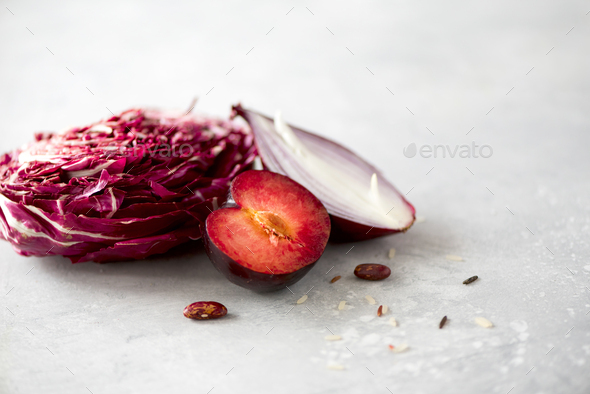 Clean eating concept. Raw purple vegetables on gray concrete background. Violet eggplant, beets - Stock Photo - Images