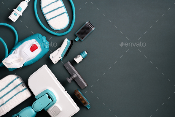 Kit of modern professional steam cleaners on grey background. Top view, flat lay. Banner with copy - Stock Photo - Images
