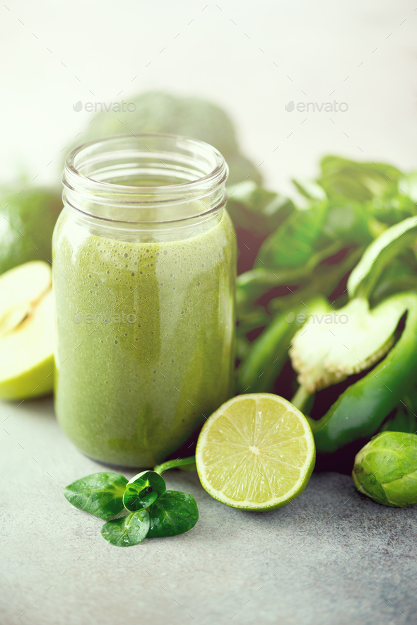 Glass jar mugs with green health smoothie. Copy space. Vegan, vegetarian concept. Alkaline food - Stock Photo - Images