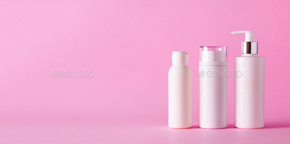 White cosmetic tubes on pink background with copy space. Skin care, body treatment, beauty concept - Stock Photo - Images
