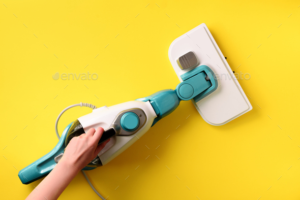 Steam cleaner mop on yellow background. Top view, flat lay. Banner with copy space. Cleaning service - Stock Photo - Images