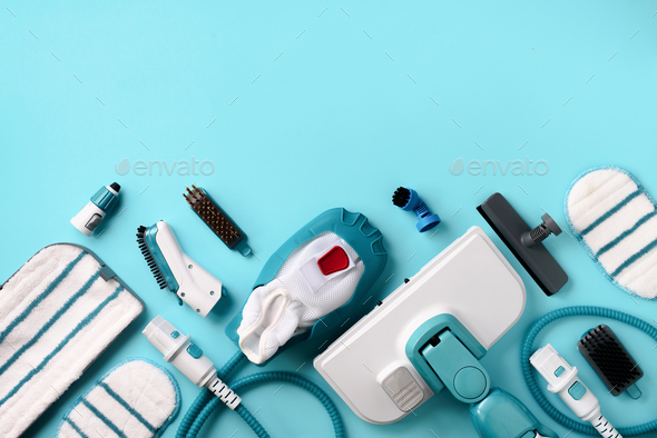 Kit of modern professional steam cleaners on blue background. Top view, flat lay. Banner with copy - Stock Photo - Images