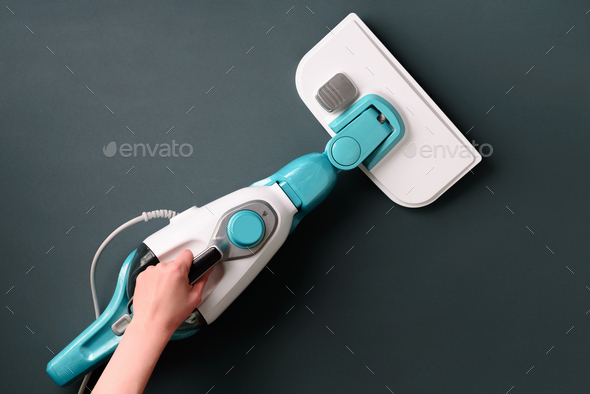 Steam cleaner mop on grey background. Top view, flat lay. Banner with copy space. Cleaning service - Stock Photo - Images