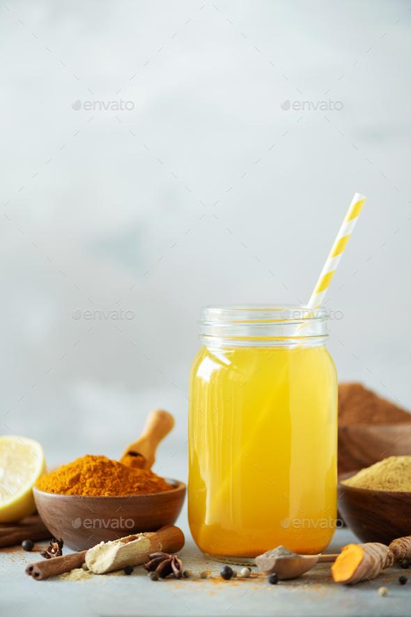 Lemon water with ginger, curcuma, black pepper. Vegan hot drink concept. Ingredients for orange - Stock Photo - Images