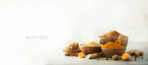 Ingredients for hot ayurvedic drink. Turmeric powder, curcuma root, cinnamon, ginger, lemon over - Stock Photo - Images