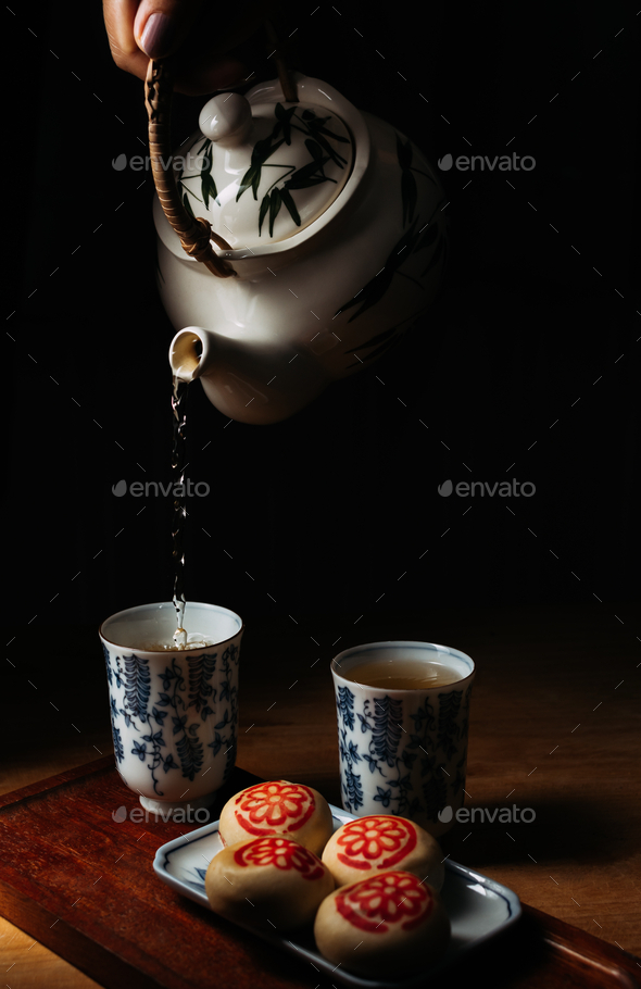 Tea and pastry on wooden table - Stock Photo - Images