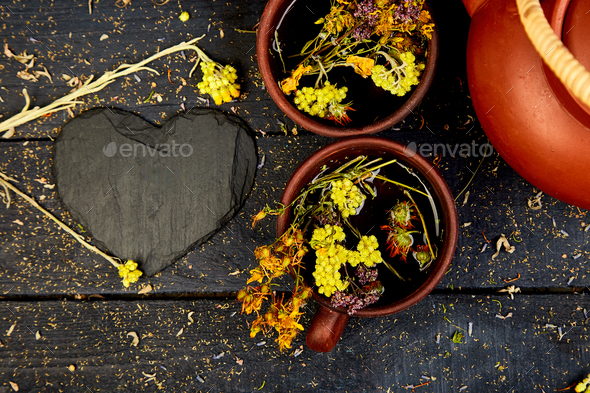 Two Cup of herbal tea. Dry Herbs and flowers, herbal medicine. - Stock Photo - Images