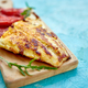 Grilled pike fillet with tomatoes on wooden board - PhotoDune Item for Sale