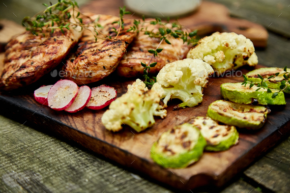 Steak turkey grill on wooden cutting board - Stock Photo - Images
