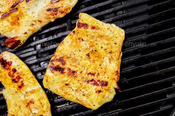 Grilled pike fillet on the gas grill. - Stock Photo - Images