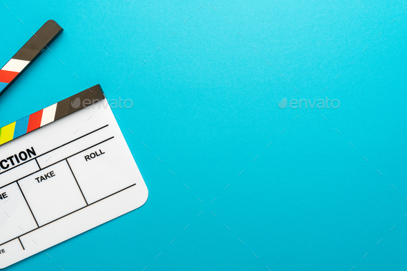 Top View Of Open White Clapperboard On Turquoise Blue Background And Copy Space - Stock Photo - Images