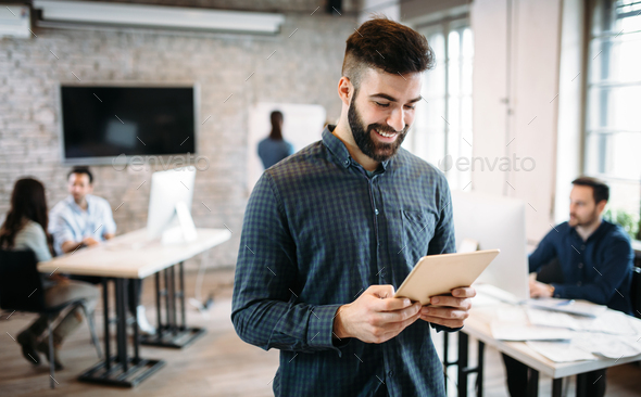 Young architect using digital tablet in office - Stock Photo - Images