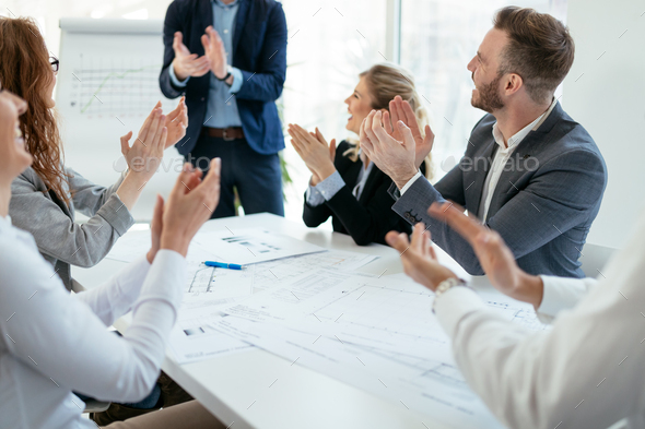 Successful company achieving goals with determined workers - Stock Photo - Images