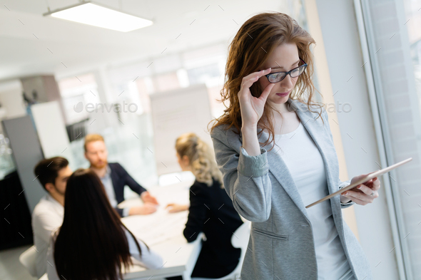Young female architect using digital tablet in office - Stock Photo - Images
